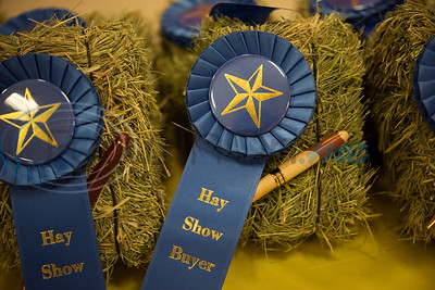 Small ceremonial bales of hay are given to auction buyers at the 35th annual Smith County Hay Show and Auction on Monday Sept. 23, 2019 at the 104th annual East Texas State Fair in Tyler. The top 25 hay entries were auctioned off to local businesses and residents to raise funds to support scholarships, the East Texas State Fair Junior Livestock Show and other programs.  (Sarah A. Miller/Tyler Morning Telegraph)