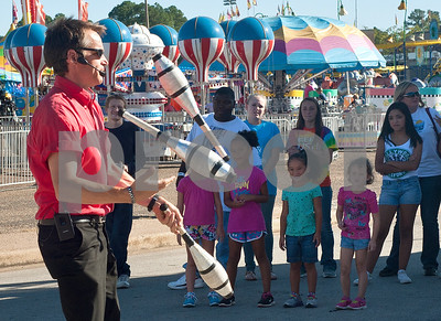 photo by Sarah A. Miller/Tyler Morning Telegraph  Entertainer Wade Henry juggles during his show at the East Texas State Fair Wednesday. Henry is known for his comedic unicycle acts, and he is also a juggler.