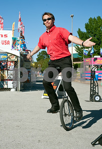 photo by Sarah A. Miller/Tyler Morning Telegraph  Entertainer Wade Henry rides a unicycle during his show at the East Texas State Fair Wednesday. Henry is known for his comedic unicycle acts, and he is also a juggler.
