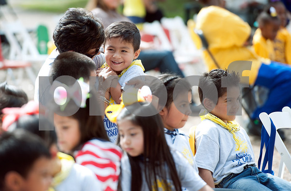 photo by Sarah A. Miller/Tyler Morning Telegraph  Preschool children from Niños de Promesa, including Eduardo Martinez, pictured at center with teacher Fabiola Hagan, attend a concert on the T.B. Butler Square Friday Sept. 26, 2014 featuring a string quartet from the East Texas Symphony Orchestra.