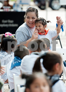 photo by Sarah A. Miller/Tyler Morning Telegraph  Preschooler Isabella Perez, 4, from Niños de Promesa, dances with teacher Geovanna Mancilla during concert on the T.B. Butler Square Friday Sept. 26, 2014 featuring a string quartet from the East Texas Symphony Orchestra.
