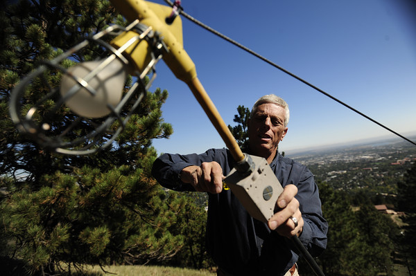 Craig Reynolds, owner of Lord and Reynolds Electrical, repairs to the damage to the Flagstaff Star in Boulder, Colorado September 28, 2012.  Reynolds has volunteered his time for a decade to keep the Flagstaff Star lit. DAILY CAMERA/ MARK LEFFINGWELL