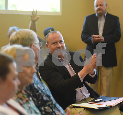 Brandon Craft applauds during a town hall meeting held Wednesday night at the Faulkner Park Police Substation. Earlier this month, Liberty Utilities proposed rates that would more than triple some customers' monthly bills for wastewater service by next March.  (Sarah A. Miller/Tyler Morning Telegraph)