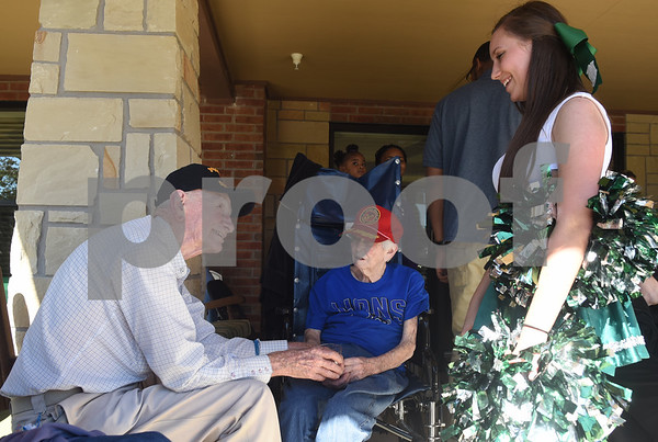Bishop T.K. Gorman Catholic High School cheerleader Katherine Watts talks with residents Robert Lewis and Betty Lewis during a tailgate at Oak Hill Terrace Memory Care in Tyler Friday afternoon Sept. 30, 2016. Bishop Gorman football players, cheerleaders, band members and Crusaderettes performed and socialized with residents of Oak Hill Terrace Memory Care during the tailgate party.  (Sarah A. Miller/Tyler Morning Telegraph)