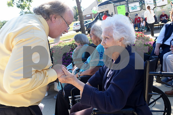 Bishop T.K. Gorman Catholic High School band director Howard Galletly talks with resident Irena Hanson during a tailgate at Oak Hill Terrace Memory Care in Tyler Friday afternoon Sept. 30, 2016. Bishop Gorman football players, cheerleaders, band members and Crusaderettes performed and socialized with residents of Oak Hill Terrace Memory Care during the tailgate party.  (Sarah A. Miller/Tyler Morning Telegraph)