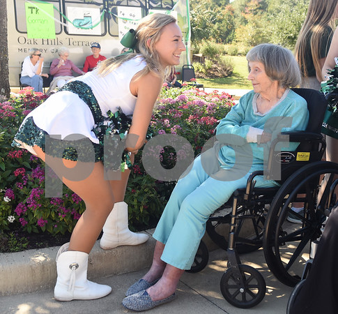 Bishop T.K. Gorman Catholic High School dancer Sara Goforth talks with resident Suzanne Ray during a tailgate at Oak Hill Terrace Memory Care in Tyler Friday afternoon Sept. 30, 2016. Bishop Gorman football players, cheerleaders, band members and Crusaderettes performed and socialized with residents of Oak Hill Terrace Memory Care during the tailgate party.  (Sarah A. Miller/Tyler Morning Telegraph)