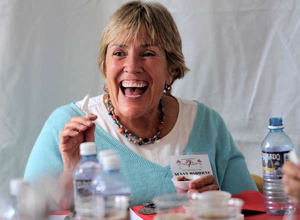 Mayor Susan Osborne laughs after tasting one of the Chili Inferno Cook Off entries during Boulder Creek Hometown Fair in Boulder, Colorado September 5, 2011.   CAMERA/Mark Leffingwell