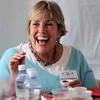 Mayor Susan Osborne laughs after tasting one of the Chili Inferno Cook Off entries during Boulder Creek Hometown Fair in Boulder, Colorado September 5, 2011.   CAMERA/Mark Leffingwell