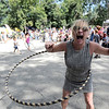 Dona Laketek laughs wildly after remembering how to keep a hula hoop going at the Boulder Creek Hometown Fair in Boulder, Colorado September 5, 2011.   CAMERA/Mark Leffingwell