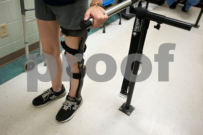 Christi Zimmerman is fitted with a new leg brace during an appointment to at the Hangar Clinic in Tyler June 5, 2015. Zimmerman cannot walk on her own without the help of the brace.   (photo by Sarah A. Miller/Tyler Morning Telegraph)