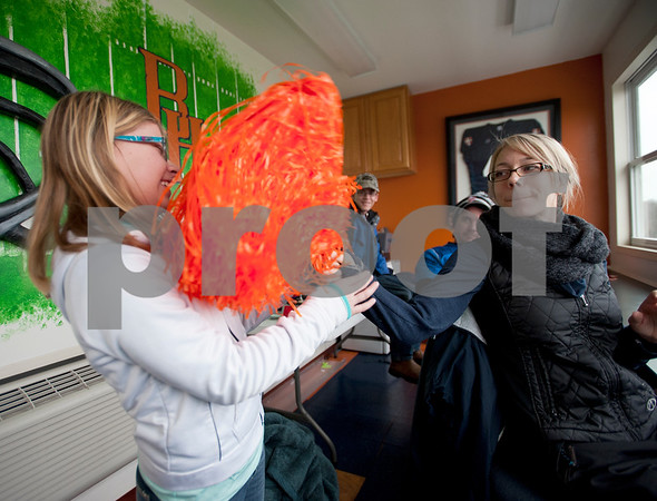 photo by Sarah A. Miller/Tyler Morning Telegraph  Christi Wyatt Zimmerman, 37, waves an orange pom pom at Jaydan Zimmerman, 12, as they watch Jordan Wyatt's high school soccer game from the press box at The Brook Hill School's Herrington Stadium Jan. 10, 2015. Zimmerman has amyotrophic lateral sclerosis, known commonly as ALS.