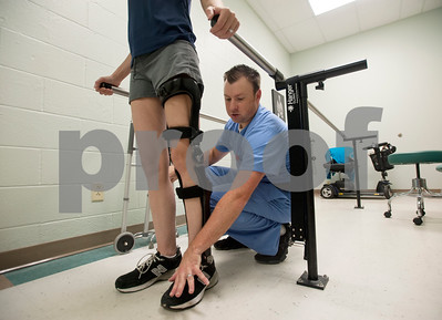 Christi Zimmerman is fitted with a new leg brace by David Keown during an appointment to at the Hangar Clinic in Tyler June 5, 2015. Zimmerman cannot walk on her own without the help of the brace.   (photo by Sarah A. Miller/Tyler Morning Telegraph)