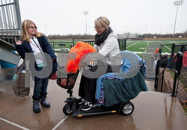 photo by Sarah A. Miller/Tyler Morning Telegraph  Christi Wyatt Zimmerman, 37, sits on her motorized chair named Scoot  as she talks with her step daughter Jaydan Zimmerman, 12, at a soccer game for her son Jordan Wyatt at The Brook Hill School's Herrington Stadium Jan. 10, 2015. Zimmerman has amyotrophic lateral sclerosis, known commonly as ALS.