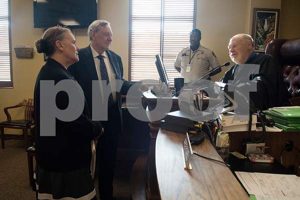 Attorneys and husband and wife duo Cynthia and Don Kent talk about their recent family trip to Big Bend with Judge Honorable Randall Rogers July 11, 2017 at the Smith County Courthouse. Mr. Kent is in the beginning stages of Lewy Body Dementia and is in the process of retiring from his law career. Lewy Body Dementia is the second most common type of dementia. Mrs. Kent is a retired State District Judge.  (Sarah A. Miller/Tyler Morning Telegraph)