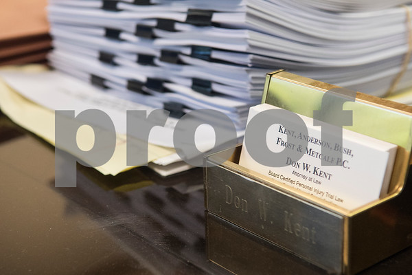 Papers are stacked on Don Kent's desk at his law office in Tyler Wednesday June 7, 2017. Kent is a Board Certified Personal Injury Trial Law attorney. He was recently diagnosed with Lewy Body Dementia.   (Sarah A. Miller/Tyler Morning Telegraph)