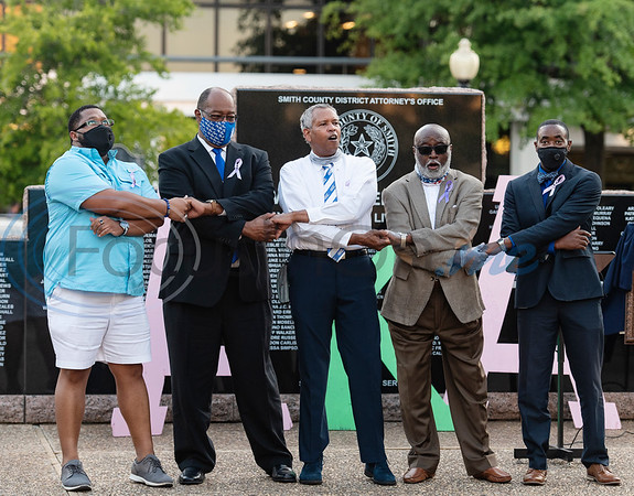 Bishop McGrew, William Hampton, Reginald Tyiska, Dr. Michael Mast and Dr. Jamie Capers link hands and sing the Phi Beta Sigma Fraternity Hymn during a celebration of life memorial for Congressman John Lewis in downtown Tyler on Friday, July 31, 2020. The event was hosted by Alpha Kappa Alpha Sorority, Inc. and Phi Beta Sigma Fraternity, Inc.