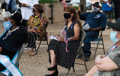 People social distance themselves while attending a program celebrating the life of Congressman John Lewis in downtown Tyler on Friday, July 31, 2020. The event was hosted by Alpha Kappa Alpha Sorority, Inc. and Phi Beta Sigma Fraternity, Inc.