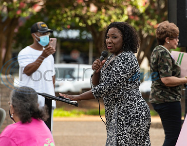 Virlinda Stanton sings during a program celebrating the life of Congressman John Lewis in downtown Tyler on Friday, July 31, 2020. The event was hosted by Alpha Kappa Alpha Sorority, Inc. and Phi Beta Sigma Fraternity, Inc.
