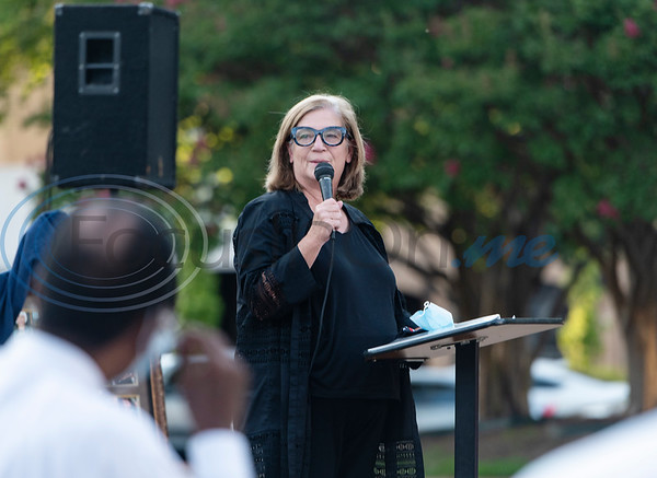 Mary Lou Tevebaugh, former president of Democratic Women of East Texas, speaks about meeting John Lewis during a celebration of life memorial for Congressman John Lewis in downtown Tyler on Friday, July 31, 2020. The event was hosted by Alpha Kappa Alpha Sorority, Inc. and Phi Beta Sigma Fraternity, Inc.