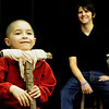 "Addison Kleinhans, left, practices his part as ""Tiny Tim"" while Michael Bouchard playing ""Bob Cratchit"" laughs in the background during a rehearsal for ""A Christmas Carol"" on Thursday, Nov. 18, at the Carlson Gymnasium on the University of Colorado campus in Boulder.<br /> Jeremy Papasso"