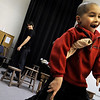 "Addison Kleinhans, 6, limps on his crutch as he practices his part of ""Tiny Tim"" during a rehearsal for ""A Christmas Carol"" on Thursday, Nov. 18, at the Carlson Gymnasium on the University of Colorado campus in Boulder.<br /> Jeremy Papasso"