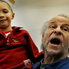 "Bob Buckley, playing the part of ""Scrooge"", holds ""Tiny Tim"" played by Addison Kleinhans during a rehearsal for ""A Christmas Carol"" on Thursday, Nov. 18, at the Carlson Gymnasium on the University of Colorado campus in Boulder.<br /> Jeremy Papasso"
