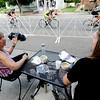 "Tari Burger, left, and Janeen Jahn, drink coffee, and watch the Sonic Boom cycling event in downtown Louisville on Saturday.<br /> For more photos of Louisville, go to  <a href=""http://www.dailycamera.com"">http://www.dailycamera.com</a>.<br /> Cliff Grassmick / July 7, 2012"