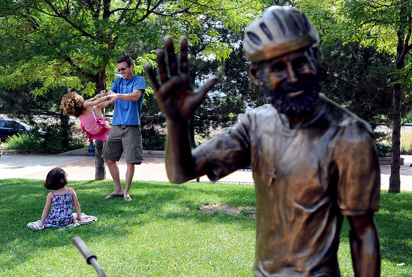 "Matt Heron swings his daughter, Makayla while his daughter Brianna watches near the John Breaux Memorial on Saturday in Louisville.<br /> For more photos of Louisville, go to  <a href=""http://www.dailycamera.com"">http://www.dailycamera.com</a>.<br /> Cliff Grassmick / July 7, 2012"