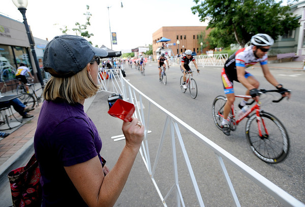 "Nicki Manzanares watches her son compete in the Sonic Boom cycling event in downtown Louisville on Saturday.<br /> For more photos of Louisville, go to  <a href=""http://www.dailycamera.com"">http://www.dailycamera.com</a>.<br /> Cliff Grassmick / July 7, 2012"