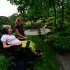 KRISTOPHER RADDER — BRATTLEBORO REFORMER<br /> Terri Ziter  and Cynthia Payne-Meyer go through the garden to look at the flowers at Payne-Maye's Putney residence on Wednesday, Aug. 7, 2018.