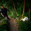 KRISTOPHER RADDER — BRATTLEBORO REFORMER<br /> Brattleboro Police Officer Brad Penniman takes a walk down to a tent encampment under the Elm Street Bridge on Sept. 5, 2018.