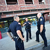 KRISTOPHER RADDER — BRATTLEBORO REFORMER<br /> Brattleboro Police Officer Brad Penniman talks with officer Mike Cable as they work on a small robbery case on Sept. 5, 2018.
