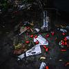 KRISTOPHER RADDER — BRATTLEBORO REFORMER<br /> Needle caps and used needles left around a tent encampment under the Elm Street Bridge on Sept. 5, 2018.