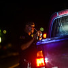KRISTOPHER RADDER — BRATTLEBORO REFORMER<br /> Brattleboro Police Officer Brad Penniman makes a traffic stop as a motorist is pulled over for a light on the vehicle being out.