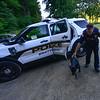 KRISTOPHER RADDER — BRATTLEBORO REFORMER<br /> Brattleboro Police Officer Brad Penniman helps bring a dog to the Windham Humane Society on Sept. 5, 2018.