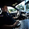 KRISTOPHER RADDER — BRATTLEBORO REFORMER<br /> Brattleboro Police Officer Brad Penniman looks at various open calls on Sept. 5, 2018.