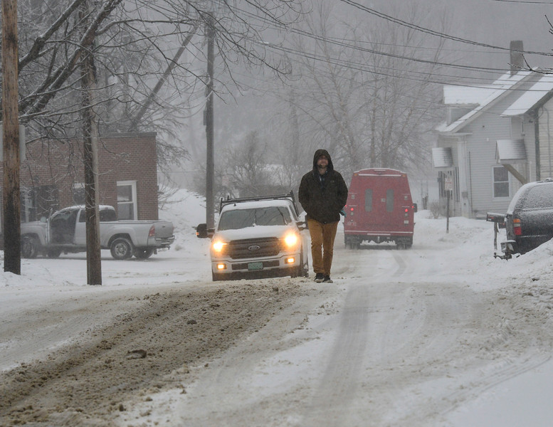 KRISTOPHER RADDER — BRATTLEBORO REFORMER<br /> Dan Edson, a Wilmington, Vt., resident, walks in the road getting to his vehicle on Monday, Dec. 30, 2019.
