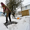 KRISTOPHER RADDER — BRATTLEBORO REFORMER<br /> Rebecca Ohm and Joel Bluming shovel off a layer of mixture mix in Jamaica, Vt., on Monday, Dec. 30, 2019.