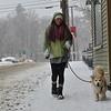 KRISTOPHER RADDER — BRATTLEBORO REFORMER<br /> Sam Smalley, of Wilmington, Vt., walks her dog Packard in Wilmington, Vt., on Monday, Dec. 30, 2019.