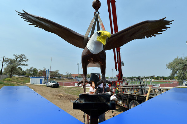 Steve Simanek, with Freeman Signs, arc welds a Bald Eagle sculpture onto it's base at Broomfield High School on the corner of Main St. and Eagle Way on Friday.<br />  August 17, 2012<br /> staff photo/ David R. Jennings