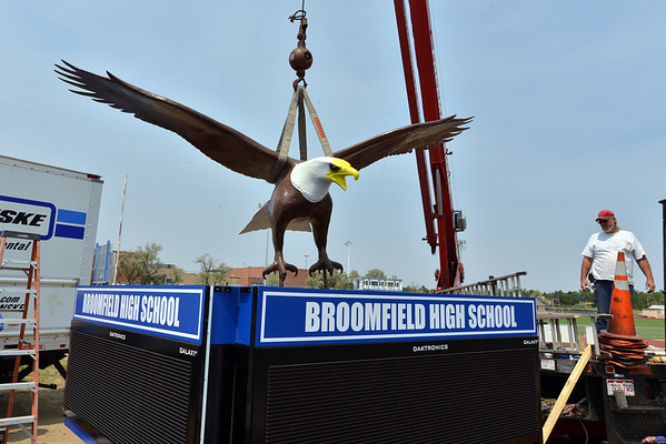 Stan Scriven, right, with Freeman Signs, watches the Bald Eagle sculpture move in to postion at Broomfield High School on the corner of Main St. and Eagle Way on Friday.<br />  August 17, 2012<br /> staff photo/ David R. Jennings