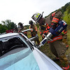 "KRISTOPHER RADDER - BRATTLEBORO REFORMER<br /> Brattleboro Capt. Dave Emery Jr uses the ""Jaws of Life"" the new spreader tool, during training on the new equipment."