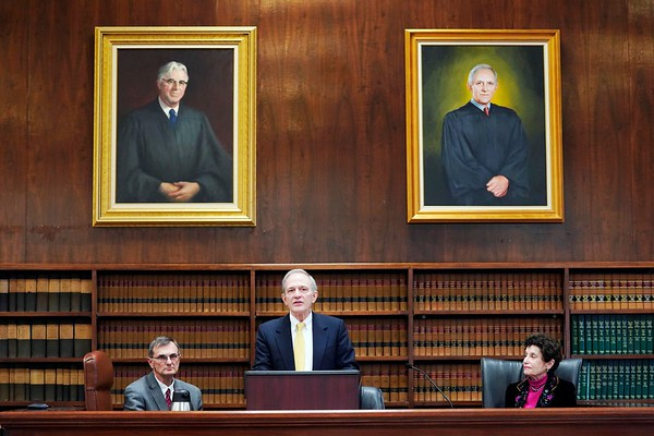 BEN GARVER — THE BERKSHIRE EAGLE<br /> Justice Francis X. Spina speaks during the ceremony of the unveiling of his portrait in Berkshire Superior Court, Friday, November 8, 2019. Judge John A. Agostini sits to the left and Justice Judith A. Cowan sits to the right. THe portrait of Spina is to the right, The portrait on the left is Justice Francis J. Quirico.