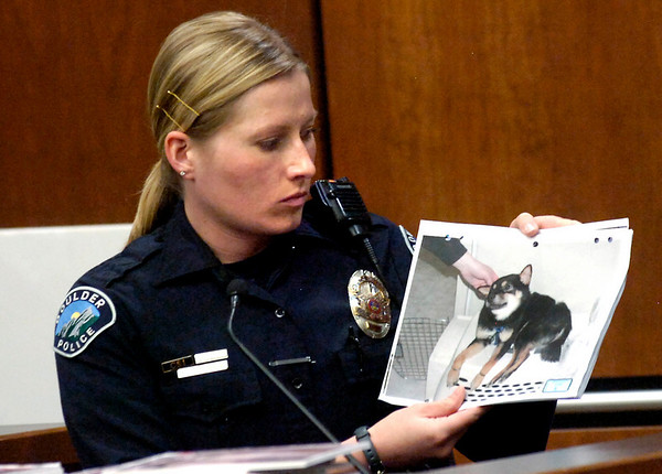 Boulder Police Officer Kara Jurczenia holds a photo of Rex after the dog was rescued from being taped to a refrigerator during the case against Abby Toll Monday afternoon in Boulder. Jurczenia responded to the original call and was the first witness in the case.<br /> Photo by Paul Aiken / The Camera /