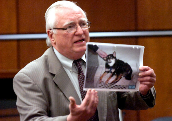 George Kokus, Abby Tolls attorney holds a photo of Rex after he was rescued by police during court proceeding at the Boulder County Courthouse Monday afternoon. Toll is being tried this week on a felony animal cruelty charge after taping her boyfriend's dog to a refrigerator last spring.<br /> Photo by Paul Aiken / The Camera /