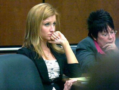 Abby Toll watches closing arguments during court proceedings at the Boulder County Courthouse Tuesday morning. Toll is being tried this week on a felony animal cruelty charge after taping her boyfriend's dog to a refrigerator last spring. Photo by Paul Aiken / The Camera / Tuesday April 13, 2010