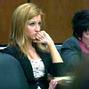 Abby Toll watches closing arguments during court proceedings at the Boulder County Courthouse Tuesday morning. Toll is being tried this week on a felony animal cruelty charge after taping her boyfriend's dog to a refrigerator last spring.<br /> Photo by Paul Aiken / The Camera / Tuesday April 13, 2010