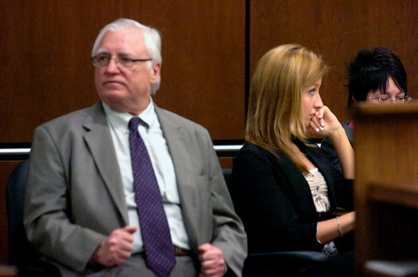 "Abby Toll and her attorney George Kokus listen to the judge ask a spectator remove a sweatshirt that had ""There is no excuse for animal abuse"" during court proceedings at the Boulder County Courthouse Tuesday morning. The judge ruled that the spectator could wear the sweatshirt except when the jury was present. Toll is being tried this week on a felony animal cruelty charge after taping her boyfriend's dog to a refrigerator last spring.<br /> Photo by Paul Aiken / The Camera / Tuesday April 13, 2010"