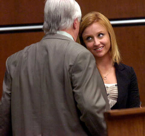 Abby Toll talks with her attorney George Kokus after closing arguments at the Boulder County Courthouse Tuesday morning. Toll is being tried this week on a felony animal cruelty charge after taping her boyfriend's dog to a refrigerator last spring.<br /> Photo by Paul Aiken / The Camera / Tuesday April 13, 2010