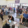 JENN SMITH -- THE BERKSHIRE EAGLE <br /> Parents line up throughout the Pittsfield High School lobby and down the hall with their students to sign off on the receipt of a new Lenovo Yoga Chromebook given this week to all students enrolled in an Advanced Placement (AP) course.